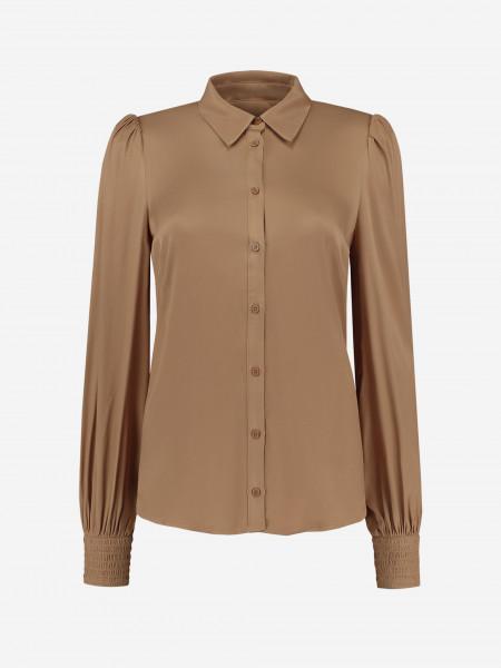 glanzende blouse met pofmouwen